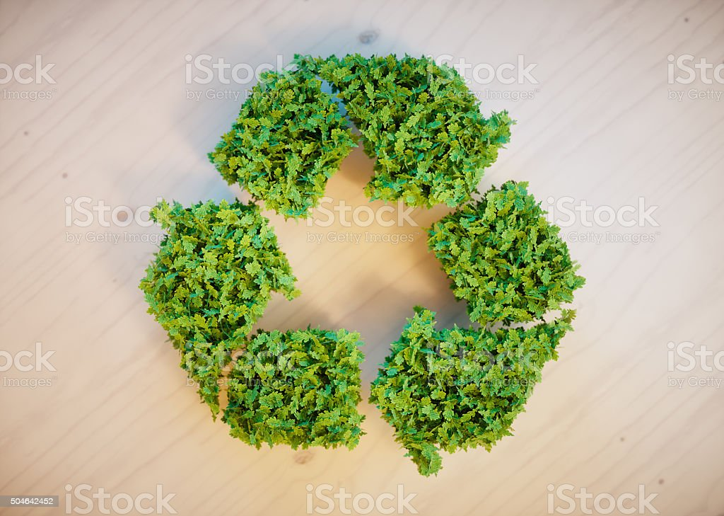 recycling symbol on wooden desk stock photo