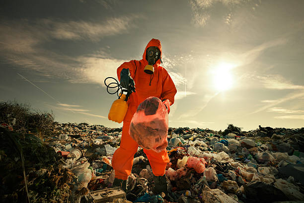 Recycling Worker on Landfill stock photo
