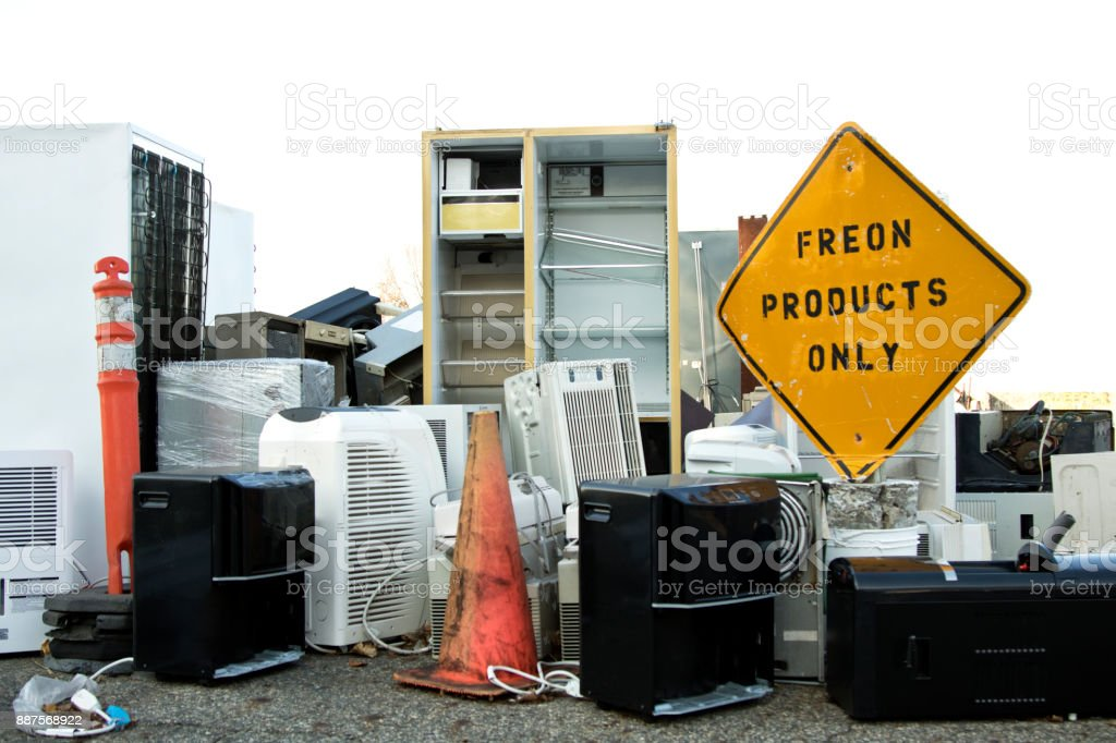 Recycling yard filled with mixed household Freon junk and garbage stock photo