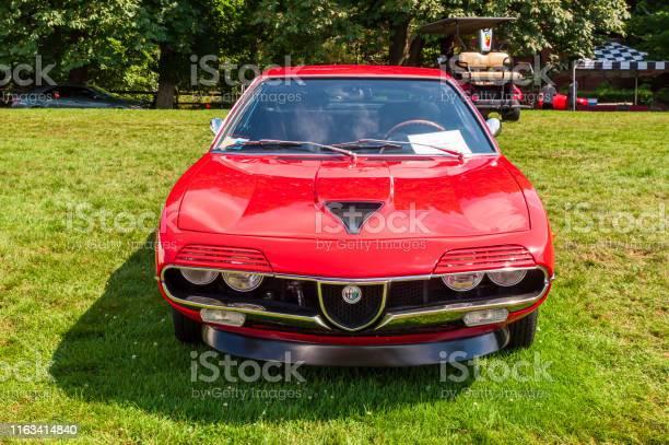 A red 1971 Alfa Romeo on display
