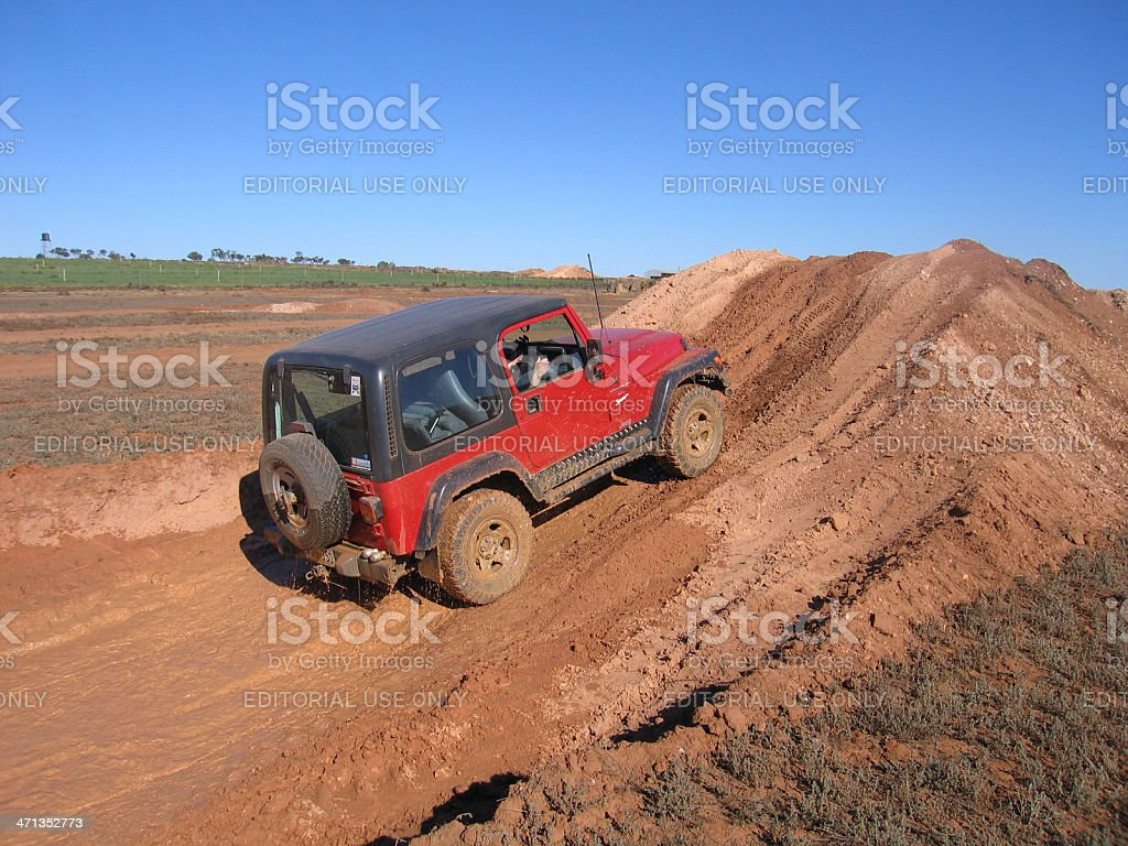 Red 1997 TJ Jeep Wrangler on 4x4 test track stock photo