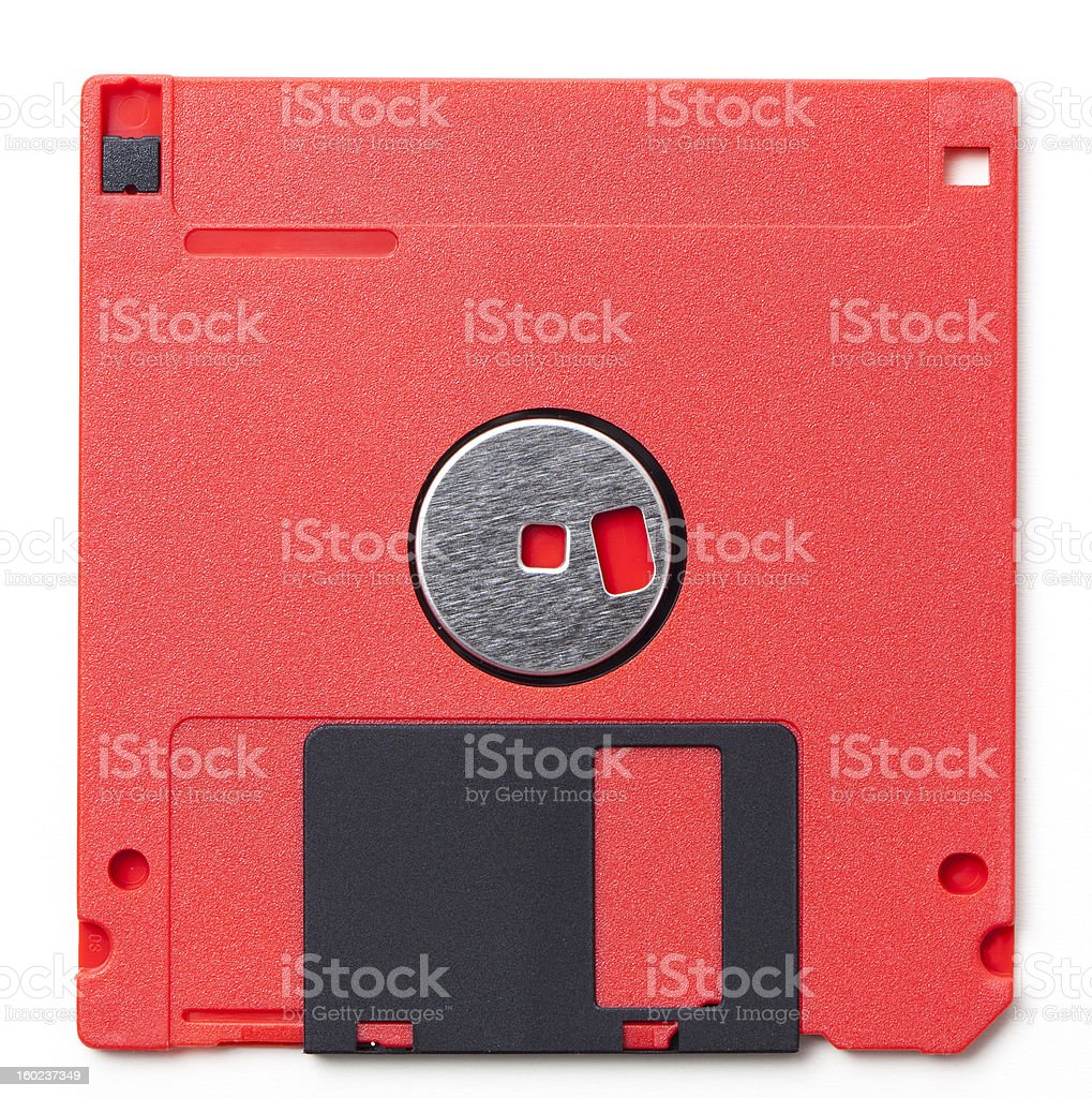 Red 3.5 inch floppy disk from the late 80s/early 90s royalty-free stock photo