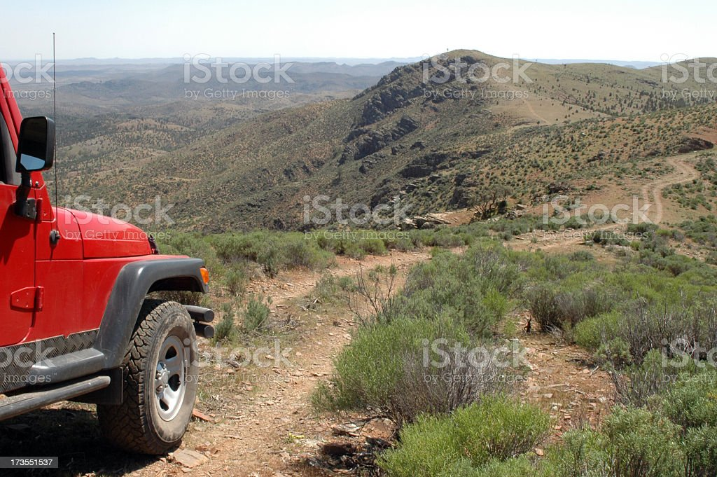 A red 4x4 vehicle driving in the Flinders Ranges stock photo