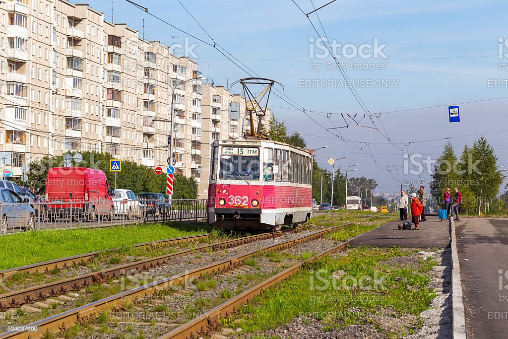 Red 71-608KM tram at the city street stock photo