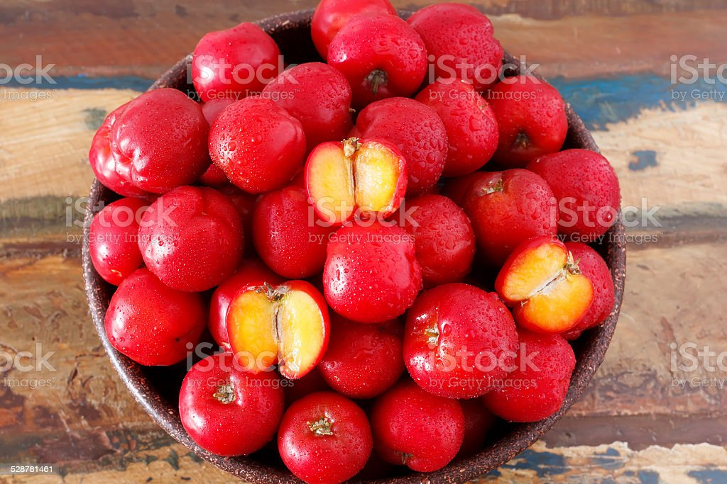 Red acerola (malpighia glabra), tropical fruit  in busket stock photo