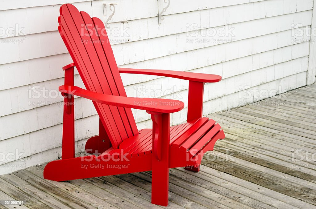 Red Adirondack Chair on a Patio stock photo