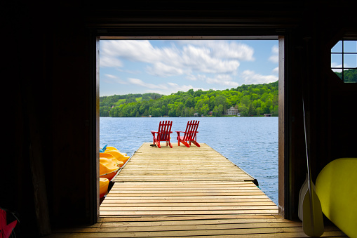 Adirondack chair on a dock at the Lake of The Woods