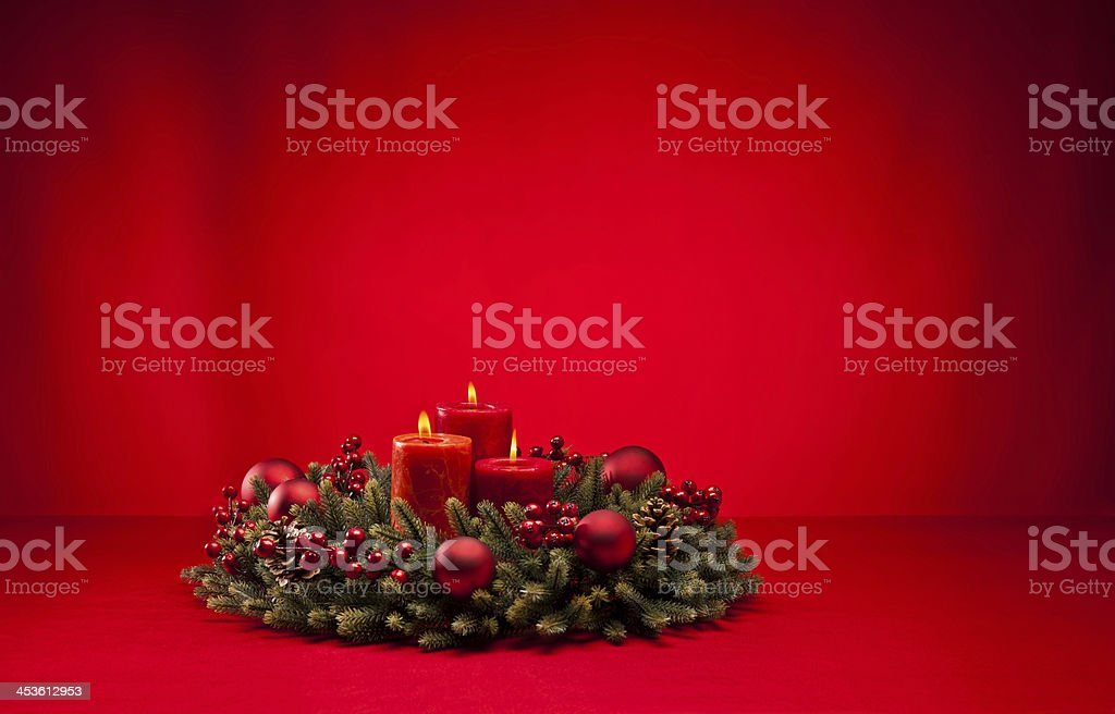 Red advent wreath with candles royalty-free stock photo