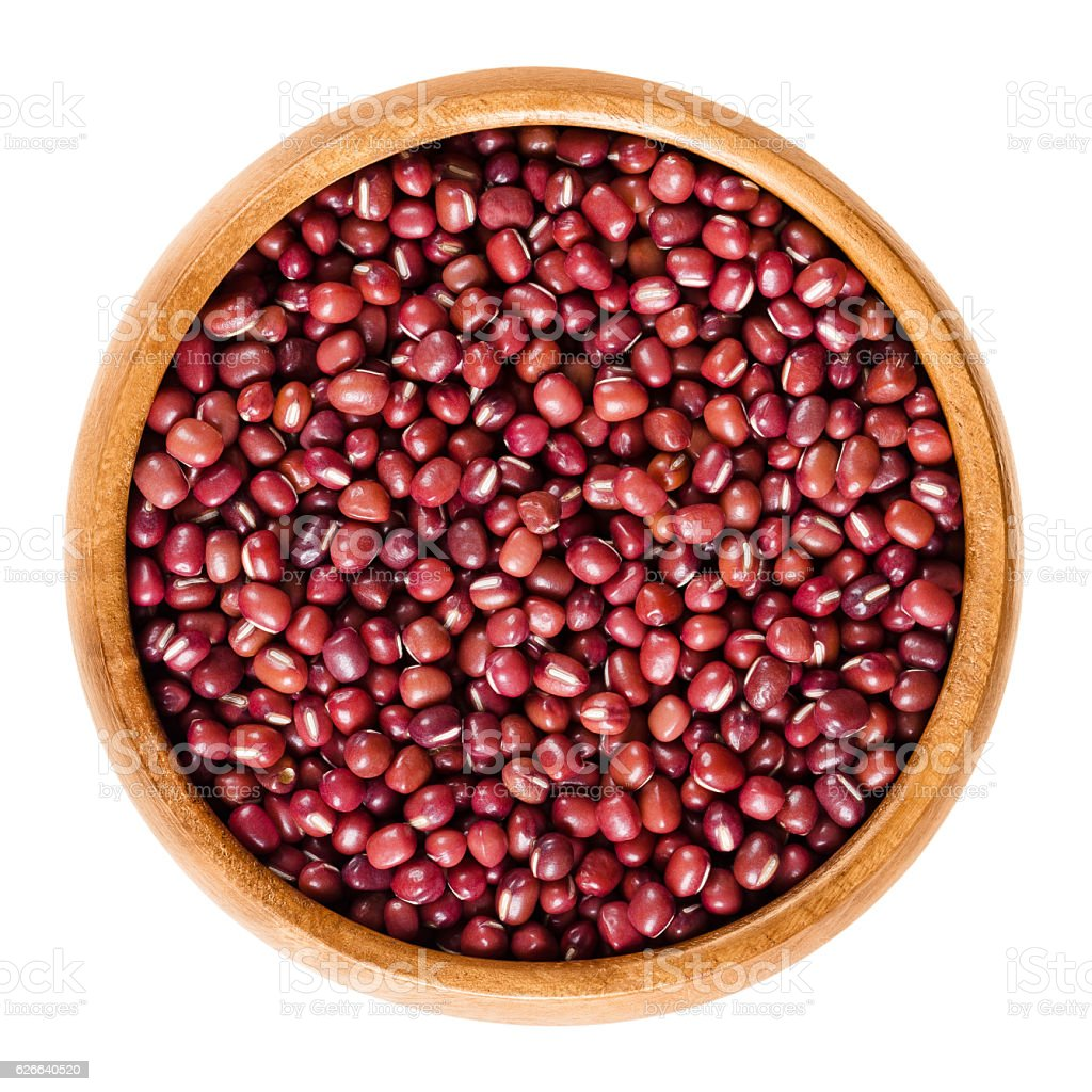 Red adzuki beans in wooden bowl over white stock photo