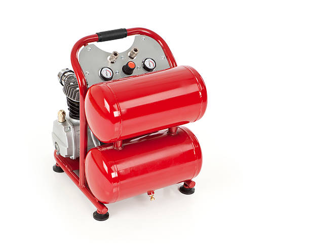 Red Air Compressor Isolated Red air compressor isolated on white.Please also see: compressor stock pictures, royalty-free photos & images