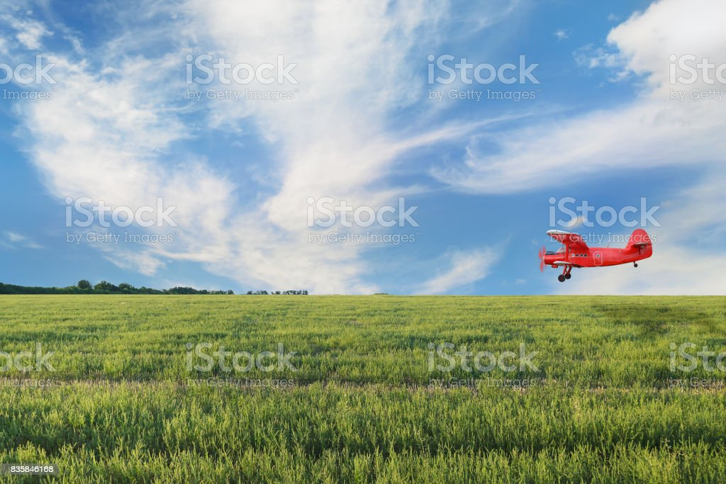 Red airplane biplane with piston engine stock photo