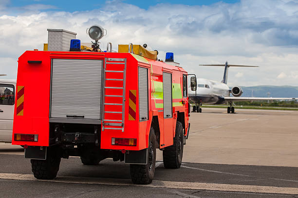 Red airport fire truck driving on the tarmac stock photo