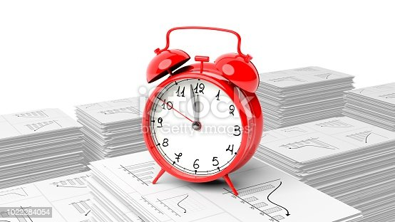 istock Red alarm cloack on stack of paperwork with graphs, isolated on white background. 1022284054