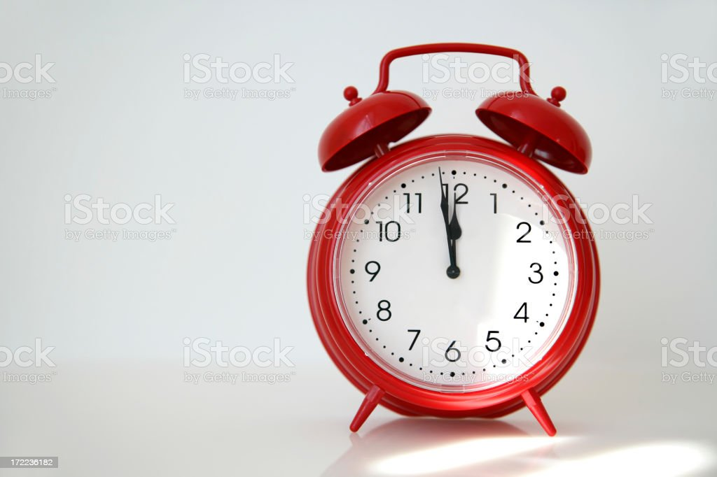 A red alarm clock on a white background royalty-free stock photo