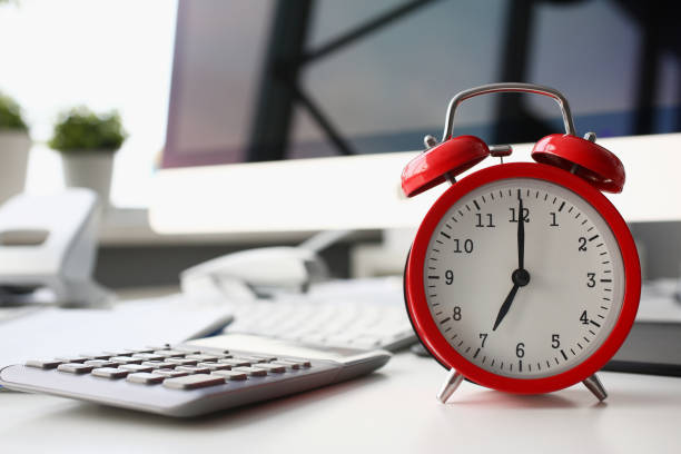 Red alarm clock set at eight in the morning closeup stock photo