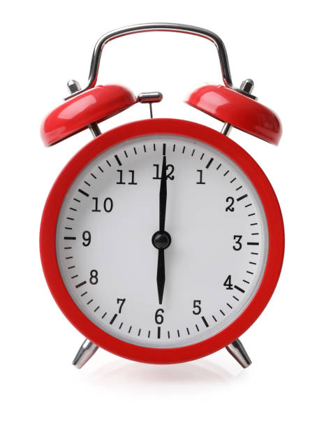 Red alarm clock set at six isolated over white background stock photo