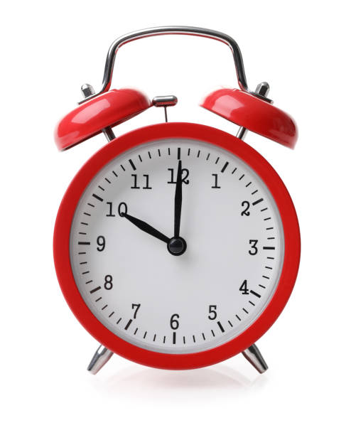 Red alarm clock set at ten isolated over white background stock photo
