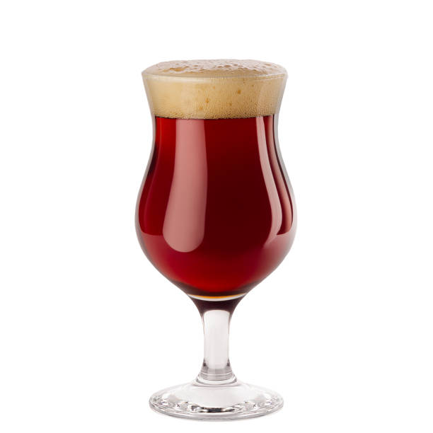 Red ale beer in wineglass with foam isolated on white background. Red ale beer in wineglass with foam isolated on white background. lager stock pictures, royalty-free photos & images