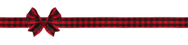 Red and black buffalo plaid Christmas gift bow and ribbon long border isolated on white stock photo