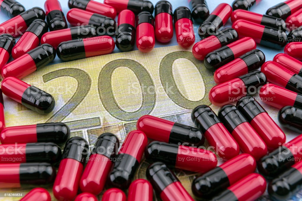 Red and black capsules up ticket of 200 euros stock photo
