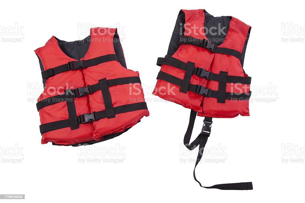 Red and black children's life jackets isolated on white stock photo