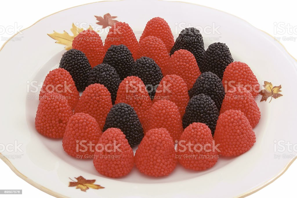 red and black gummy blackberry on plate royalty-free stock photo