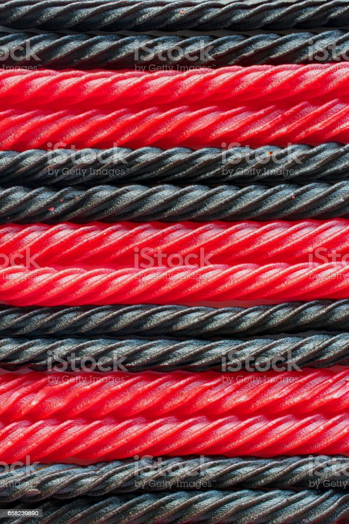 Red and Black liquorice candy bars - texture or background stock photo