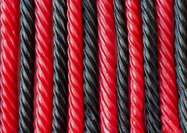red and black liquorice candy bars - texture or background - liquirizia foto e immagini stock