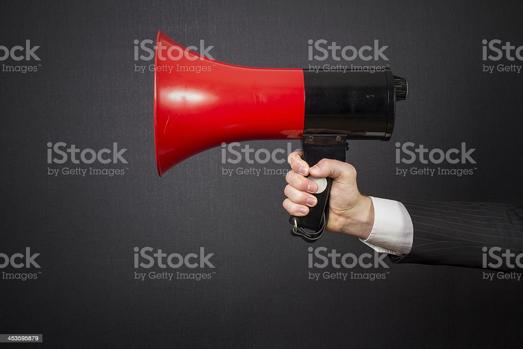 Red and black Megaphone in hand stock photo