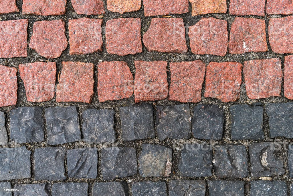 Red and black stones road surface zbiór zdjęć royalty-free