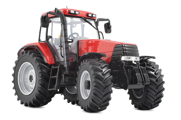 Red and black tractor against white background stock photo