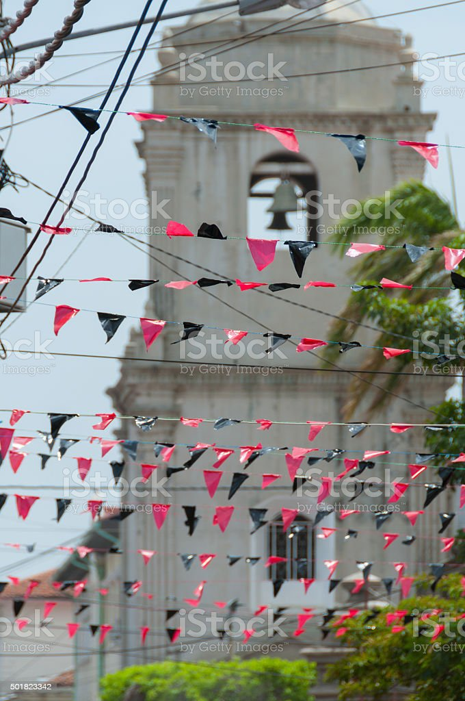Red and Black Triangled Plastics Hanging on The Lines in stock photo