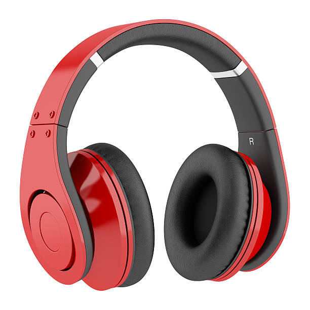 Red and black wireless headphones on a white background stock photo