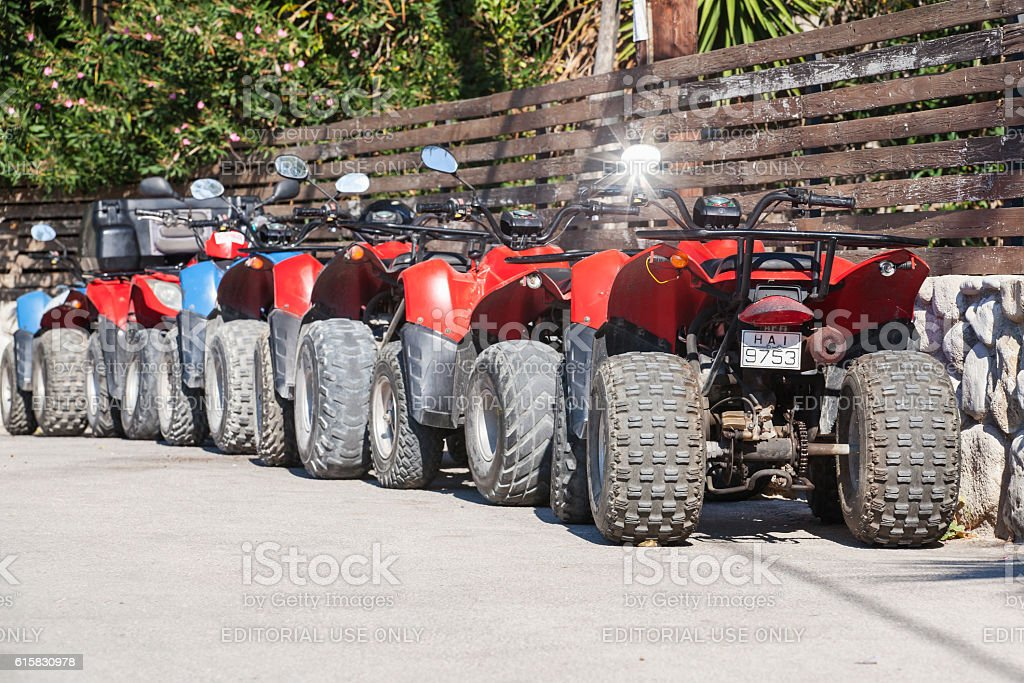 Red and blue atv quad bikes stock photo