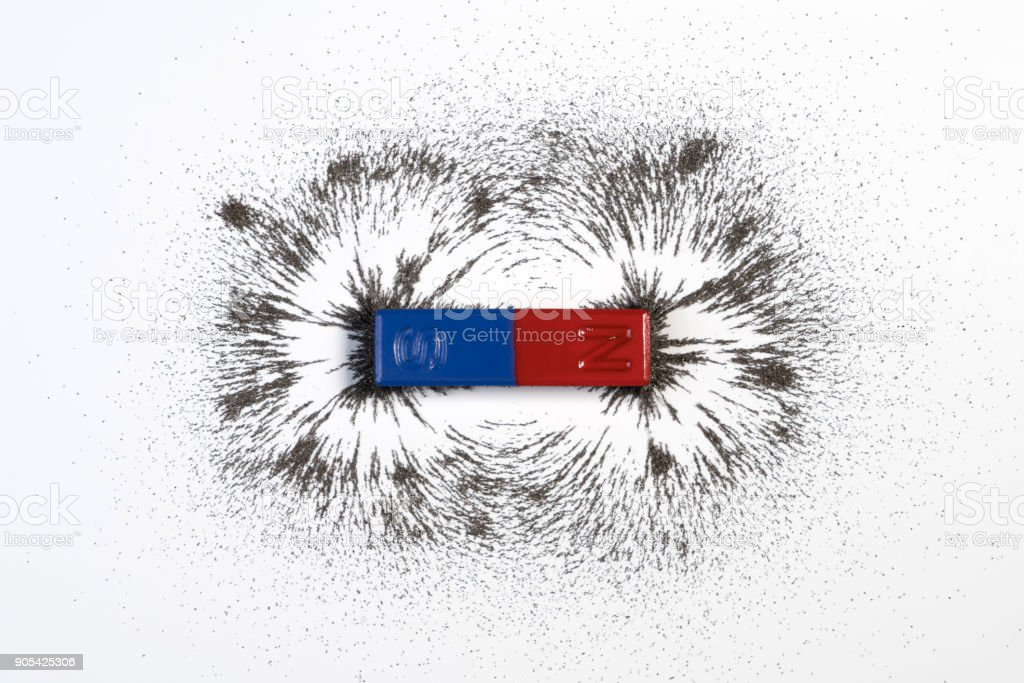 Red and blue bar magnet or physics magnetic with iron powder magnetic field on white background. stock photo