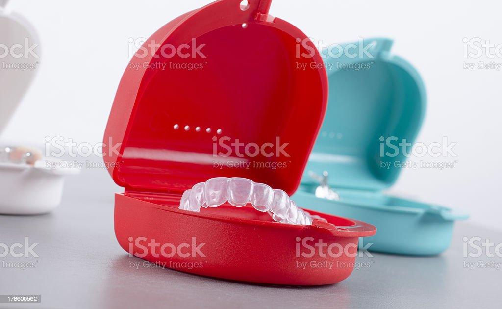 Red and blue box with transparent bleach retainer royalty-free stock photo