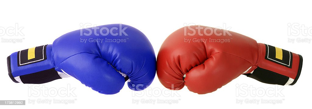 Red and blue boxing gloves with a white backdrop stock photo
