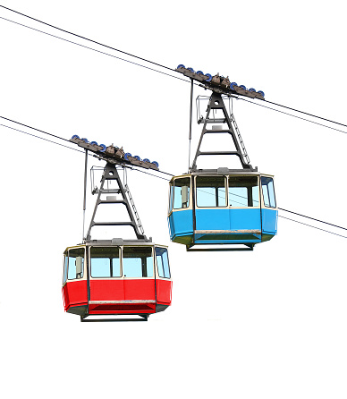 Red and blue cable car isolated on white background. Retro technology and transportation theme.