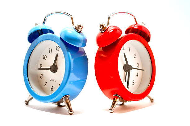 Red and blue clocks stock photo