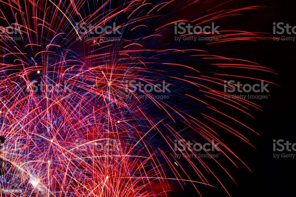 Red and blue fireworks stock photo