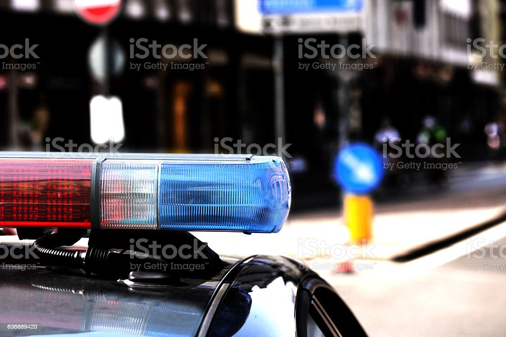 Red and blue flashing lights of the police car stock photo