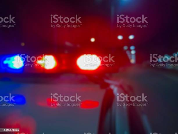 Red And Blue Flashing Police Car Lights At Night Crime Scene Abstract Blurry Image To Illustrate Criminal News And Events Stock Photo - Download Image Now
