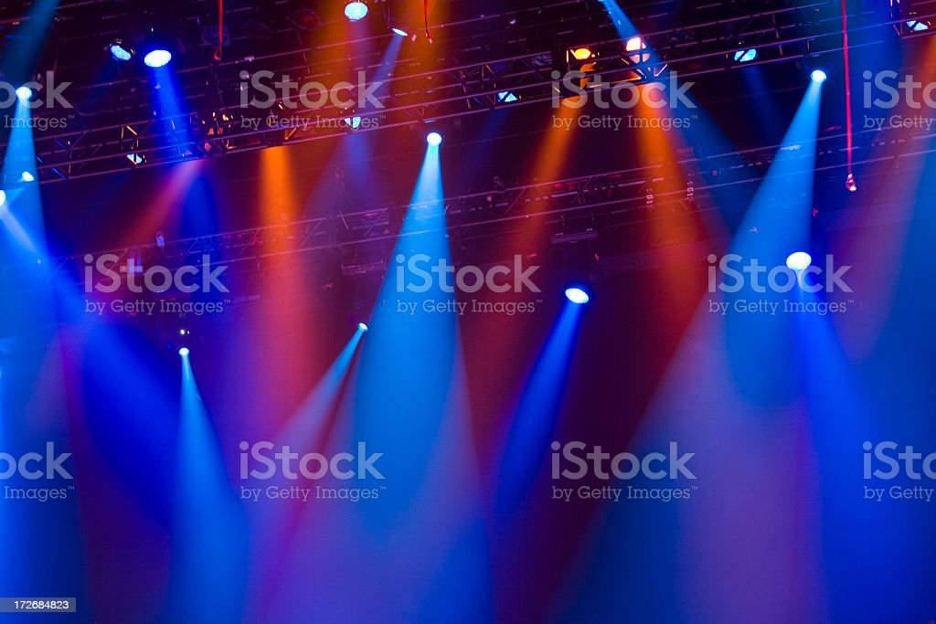 Red and blue lighting attached to a metal row in a concert royalty-free stock photo