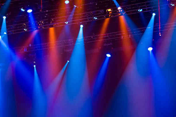 Red and blue lighting attached to a metal row in a concert stock photo