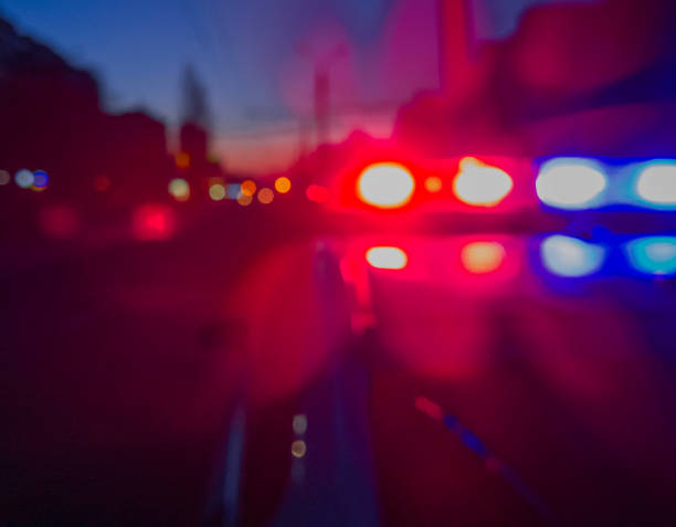 Red and blue Lights of police car in night time. Night patrolling the city. Abstract blurry image. stock photo