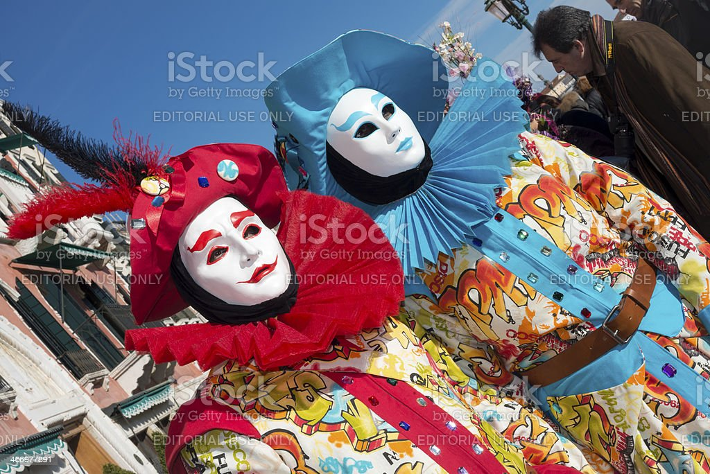 Red and Blue Masks at 2013 Venice Carnival, Italy, Europe royalty-free stock photo