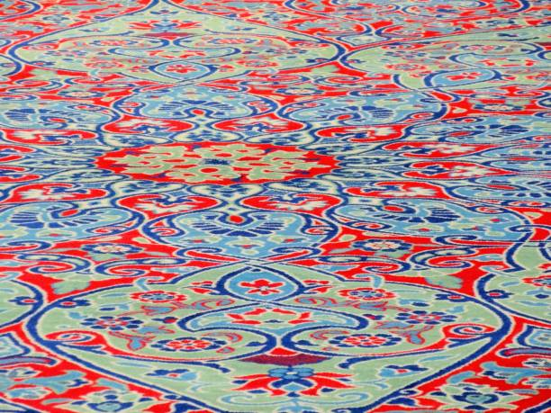 Red and blue mosque carpet in istanbul stock photo