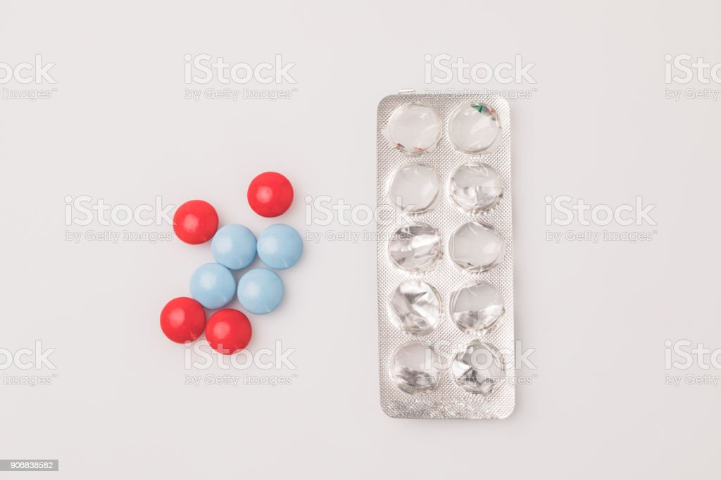 red and blue pills and blister pack stock photo