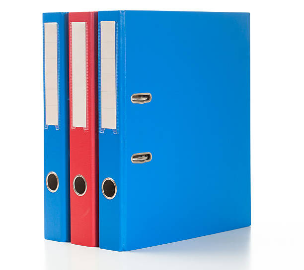 Red and blue ring binders stock photo