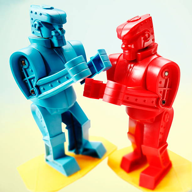 Red and Blue Robots Fighting stock photo